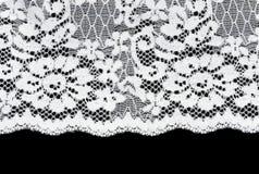 Laço branco em um fundo preto Fotografia de Stock