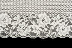 Laço branco modelado no fundo preto imagem de stock royalty free
