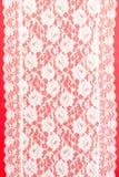Laço branco no vermelho Foto de Stock
