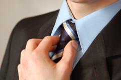 Laço e mão de homem de negócio Fotografia de Stock