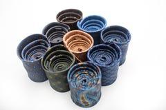Laços rolados obscuridade com testes padrões coloridos Fotografia de Stock Royalty Free