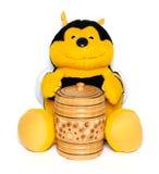 La abeja de la felpa con un barrilete de la miel Foto de archivo libre de regalías