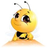 La abeja se sienta con una cuchara Imagenes de archivo