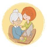 La abuelita aprende el uso del ordenador con la ayuda de la muchacha Imagen de archivo