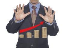 La acción del hombre de negocios hace el dinero con magia negra Fotos de archivo