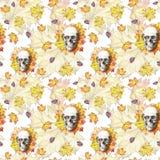 La acuarela que dibuja el cráneo humano del fondo inconsútil para Halloween con amarillo del otoño se va y florece en los zócalos
