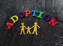 La adopción pone letras a la familia Imagen de archivo libre de regalías