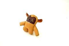 La aduana handcrafted rellenó el perro de oro del juguete de cuero - derecho Imágenes de archivo libres de regalías
