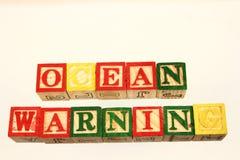 La advertencia del océano del término Imágenes de archivo libres de regalías