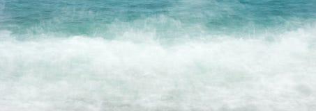 La agua de mar de la bandera del web agita el fondo de la espuma imagen de archivo