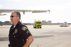 LA Airport Police and fire department on tarmac. Los Angeles airport police and fire department supervise the off-loading of passengers on the tarmac after royalty free stock photos