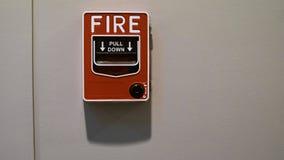 La alarma de incendio para tira hacia abajo en el edificio de oficinas, Bangkok Tailandia Fotos de archivo libres de regalías