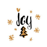 La alegría - letras manuscritas únicas del día de fiesta hechas con tinta y seca el cepillo Elementos del diseño de la Navidad Imagen de archivo