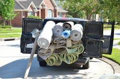 La alfombra rueda en furgoneta Fotografía de archivo