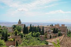 View of the Alazaba of La Alhambra on a clear summer day. La Alhambra complex and alcazaba in Granada, Spain - taken from the Generalife gardens Stock Image