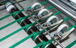 La alimentación plegable de los cinturones verdes de la máquina rueda el metal Applian industrial Fotografía de archivo libre de regalías