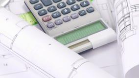 La alta vista de planes, de la calculadora y del diseño se opone el torneado stock de ilustración