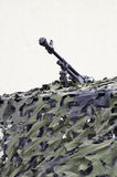 La ametralladora pesada disfrazada imagen de archivo libre de regalías