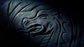 La antorcha enciende para arriba a Dragon Carving On Cave Wall almacen de metraje de vídeo
