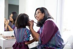 La aplicación de la madre y de la hija compone junta imagenes de archivo