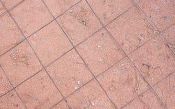 La arena anaranjada alisa con la reja del acero del fino-grado Foto de archivo libre de regalías