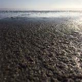 La arena mojada Fotografía de archivo libre de regalías