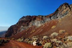 La arena y las rocas rojas en la cala de Tacoron, EL Hierro Fotografía de archivo
