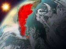 La Argentina en la tierra del planeta en puesta del sol Imagen de archivo
