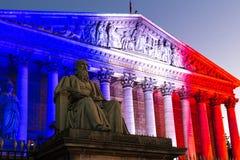 La asamblea nacional francesa se encendió para arriba con colores de la bandera nacional francesa, París Foto de archivo libre de regalías