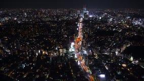 La autopista metropolitana no Línea y ciudad, visión de 3 Shibuya desde Roppongi Hills Mori Tower, Tokio, Japón almacen de metraje de vídeo