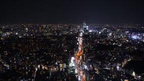 La autopista metropolitana no Línea y ciudad, visión de 3 Shibuya desde Roppongi Hills Mori Tower, Tokio, Japón metrajes
