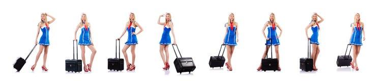 La azafata con equipaje en blanco imagenes de archivo