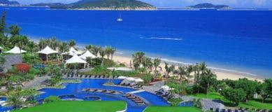 La baie de yalong de station de vacances de Holiday Inn, Chinois de Sanya font du jardinage Photographie stock libre de droits