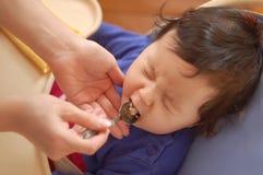 La bambina non vuole mangiare Fotografie Stock