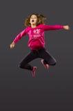 La bambina salta Fotografie Stock