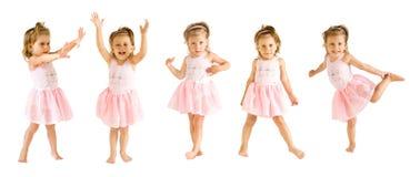 La bambina in un vestito della ballerina balla Fotografie Stock