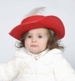 La bambina in vestiti celebratori Fotografia Stock