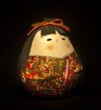 La bambola giapponese fortunata Immagine Stock