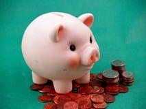 La Banca con le monete Fotografie Stock Libere da Diritti