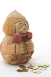 La Banca e monete di legno della scimmia Immagine Stock