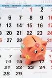 La Banca Piggy alle pagine del calendario Immagini Stock