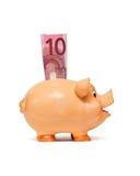 La Banca Piggy con la nota dell'euro 10 Fotografia Stock