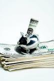 La Banca Piggy di risparmio con soldi Fotografia Stock Libera da Diritti
