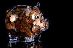 La Banca Piggy libera in pieno dei penny americani Immagine Stock