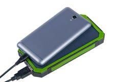 La Banca portatile di potere per i dispositivi mobili di carico Fotografia Stock