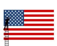 La bandera americana de los E.E.U.U., hombre pone una estrella - ejemplo Fotos de archivo