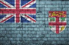 La bandera de Fiji se pinta sobre una pared de ladrillo vieja fotografía de archivo libre de regalías