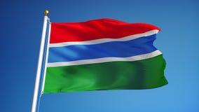 La bandera de Gambia en la cámara lenta inconsútil colocó con alfa libre illustration