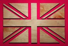 la bandera de Gran Bretaña, de rayas y de triángulos talló de la madera imagen de archivo libre de regalías