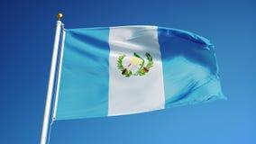 La bandera de Guatemala en la cámara lenta inconsútil colocó con alfa ilustración del vector